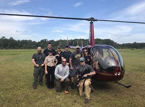 Group Around Helicopter